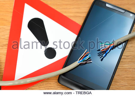 Mobiltelefon mit dem Symbol Gefahrstelle und einem durchtrennten Telefonkabel | Mobile phone with the sign danger spot and a severed phone cable | BLW - Stock Photo