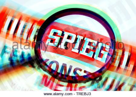 The German news magazine DER SPIEGEL under a magnifying glass - fake stories, Bundesrepublik Deutschland - Stock Photo