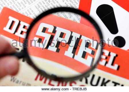 The German news magazine DER SPIEGEL under a magnifying glass - fake stories - Stock Photo
