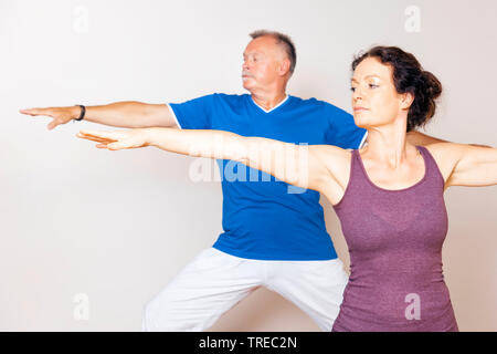 Frau und Mann machen Yoga-Uebungen, Europa | woman and man doing yoga, Europe | BLWS522571.jpg [ (c) blickwinkel/McPHOTO/M. Gann Tel. +49 (0)2302-2793 - Stock Photo