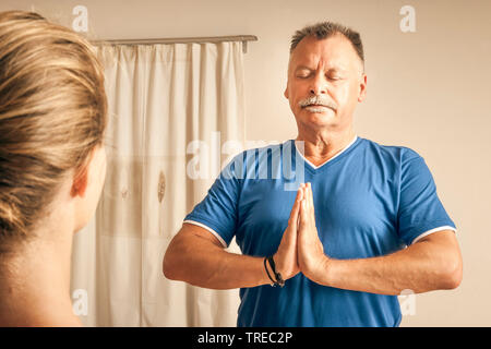 Frau und Mann machen Yoga-Uebungen, Europa | woman and man doing yoga, Europe | BLWS522572.jpg [ (c) blickwinkel/McPHOTO/M. Gann Tel. +49 (0)2302-2793 - Stock Photo