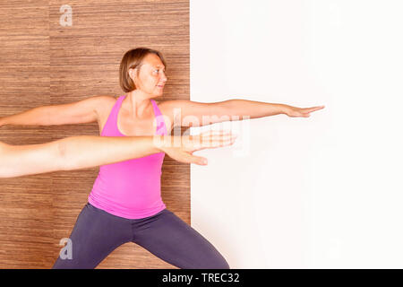 Frau und Mann machen Yoga-Uebungen, Krieger, Europa | woman and man doing yoga, warrior, Europe | BLWS522582.jpg [ (c) blickwinkel/McPHOTO/M. Gann Tel - Stock Photo