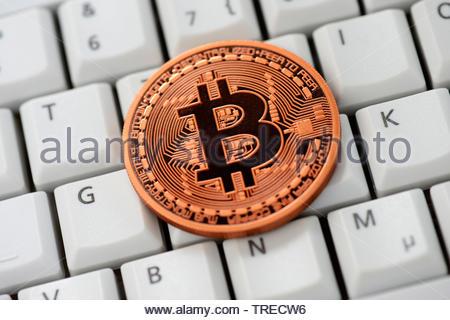 Bitcoin on a keyboard - Stock Photo