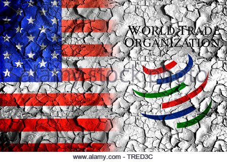 US flag and WTO logo next to each other - trade conflict - Stock Photo