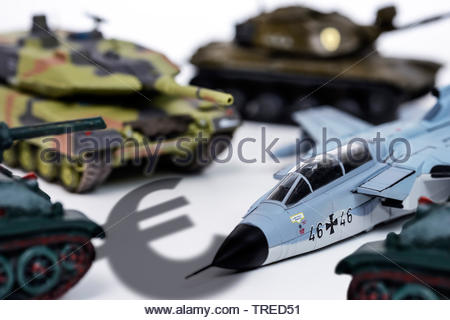 Military toys (tanks and aircrafts) and an Euro sign - defence budget - Stock Photo