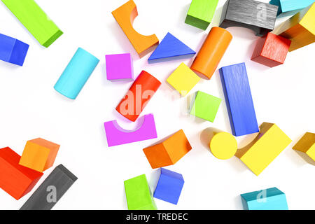 Multicolored wooden bricks on white surface - Stock Photo