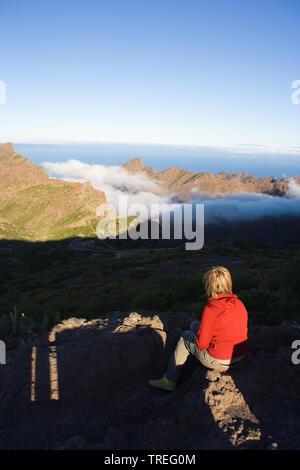 woman enjoying the view of the gorge of Masca, Canary Islands, Tenerife, teno, Masca - Stock Photo