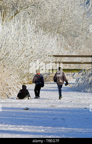 children playing on frozen ditch, Netherlands - Stock Photo