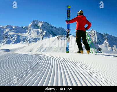 Ski track early ont the morning in  the ski resort of sainte Foy in Tarentaise valley, Mont Pourri, 3770 m, in the background, France, Savoie, Vanoise National Park - Stock Photo
