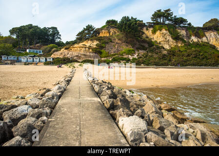 Stone Groynes on Branksome Dene Chine beach near Bournemouth in Dorest, England, UK. - Stock Photo