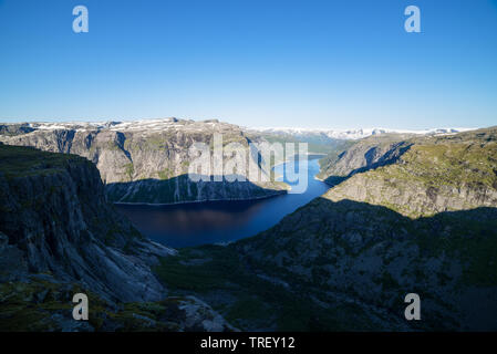 Ringedalsvatnet Lake. View from the Trolltunga cliff. Tourist attraction of Norway. Sunny morning - Stock Photo