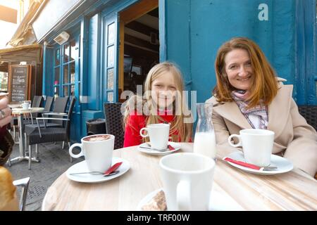 mother and daughter at the traditional french caffee. Morlaix, France - Stock Photo