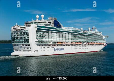 P and O Cruises / P & O cruise ship The MV Azura, setting off / sail / leaving Southampton port on a cruise on a sunny day with blue sky and sun. UK (99) - Stock Photo