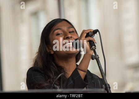 4 June ,2019.. London,UK.  Ash Sarkar, journalist and political activist addresses the crowd on Whitehall. Tens of Thousands protest in Central London in a National demonstration against US President Donald Trumps State visit to the UK. Protesters rallied in Trafalgar Square before marching down Whitehall to Downing Street, where Trump was meeting UK Prime Minister Theresa May. David Rowe/Alamy Live News. - Stock Photo