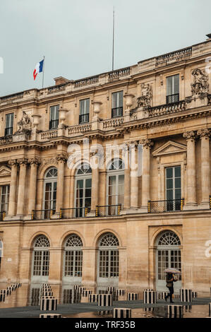 Building and inner courtyard on rainy day at the Palais-Royal in Paris. One of the most impressive world's cultural center in France. - Stock Photo