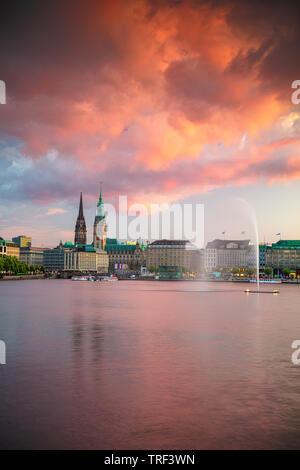 Hamburg, Germany. Cityscape image of Hamburg downtown with City Hall during sunset. - Stock Photo