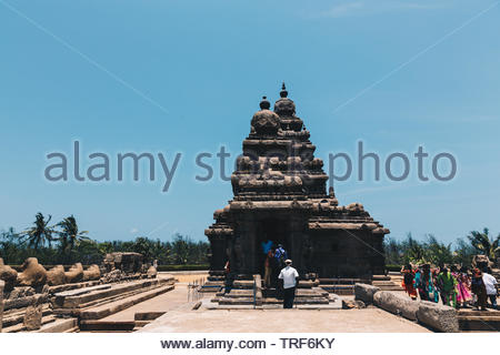 The Shore Temple is a carved monolithic pyramidal structures from one big granite in the Mahabalipuram compound of Tamil Nadu near Chennai, India - Stock Photo
