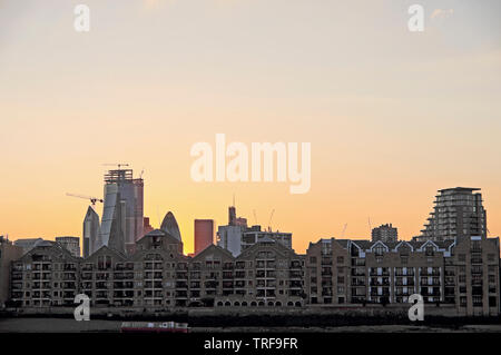 Wapping row of terraced houses apartments on River Thames riverside waterfront & view of the City of London & Shard from Rotherhithe UK  KATHY DEWITT - Stock Photo