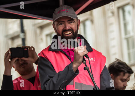 4 June ,2019.. London,UK. Chris Webb, Head of Communications at the CWU addresses the crowd on Whitehall. Tens of Thousands protest in Central London in a National demonstration against US President Donald Trumps State visit to the UK. Protesters rallied in Trafalgar Square before marching down Whitehall to Downing Street, where Trump was meeting UK Prime Minister Theresa May. David Rowe/Alamy Live News. - Stock Photo