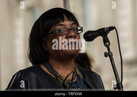 4 June ,2019.. London,UK. Diane Abbott, Labour MP and Shadow Home Secretary addresses the crowd on Whitehall. Tens of Thousands protest in Central London in a National demonstration against US President Donald Trumps State visit to the UK. Protesters rallied in Trafalgar Square before marching down Whitehall to Downing Street, where Trump was meeting UK Prime Minister Theresa May. David Rowe/Alamy Live News. - Stock Photo