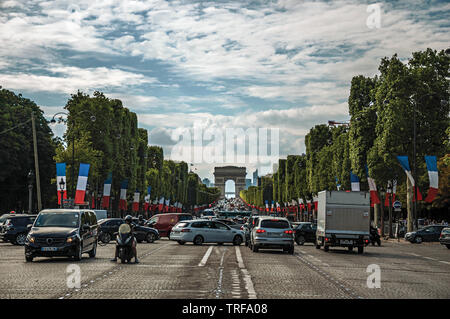 Trees and cars on the Champs-Elysees Avenue in Paris. One of the most impressive world's cultural center in France. - Stock Photo