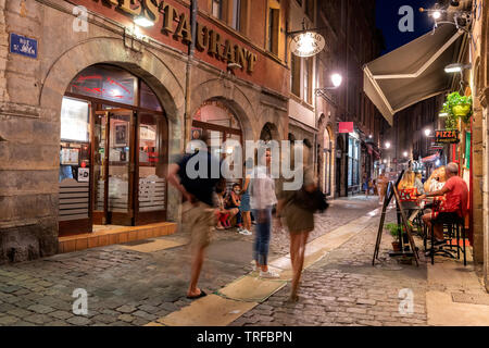 LYON, FRANCE - August 21, 2018: Colorful saint Jean district in old Lyon, the famous and typical old town of the city of Lyon by night. People on the - Stock Photo
