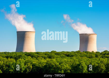 Steaming Cooling Towers at Nuclear Power Plant - Stock Photo