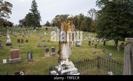Aerial Image Close Up View Weathered Angel Sculpture Headstone Historic Old American Civil War Graveyard Rose Hill Oldest Cemetery Hagerstown Maryland - Stock Photo