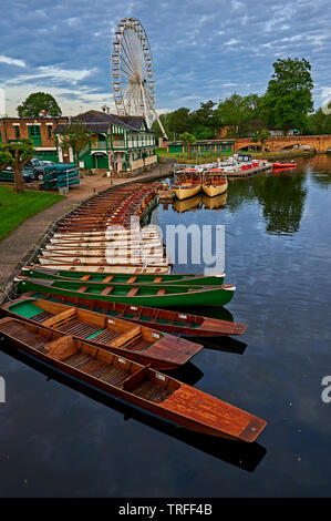 Stratford upon Avon, Warwickshire and boats moored on the River Avon early on a summer morning. - Stock Photo