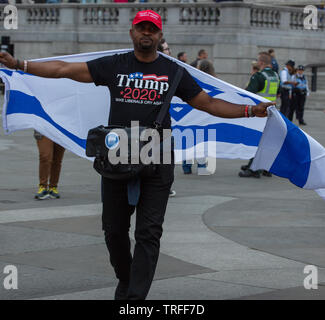 London, UK. 4th June 2019. Trump supporter with the flag of Israel on Trafalgar Square on the day protesters holding a day of protest in central London on Trafalgar Square against the President of the USA, Donald Trump, visiting the UK. Credit: Joe Kuis / Alamy - Stock Photo