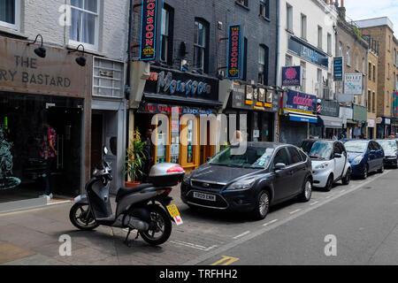 Shops on Brick Lane, London, England. - Stock Photo