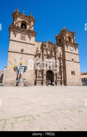 Magnificent Catedral Basílica San Carlos Borromeo or Puno Cathedral in the Plaza de Armas or Main Square of Puno, Peru - Stock Photo
