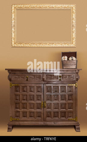 Empty golden frame and a spanish style old wood furniture - Stock Photo