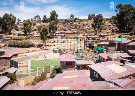 Scenic view with the Cemetery and football field in the foreground on Taquile Island hillside, Lake Titicaca, Puno Region, Peru - Stock Photo