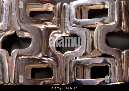 Interesting pattern on a silver wrist bracelet - Stock Photo