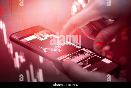 Stock crisis red price drop down chart fall business and finance crash money losing moving / Businessman use smartphone in hand trading online forex i - Stock Photo