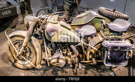 Colleville sur Mer, France - May 5, 2019: Military BMW R75 motorcycle with sidecar in the Overlord museum at Normandy France. - Stock Photo
