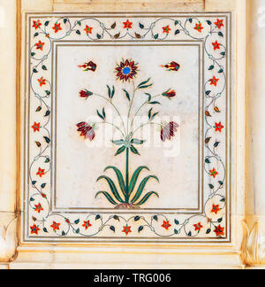Delicate flower motifs made of coloured marble inlays in white marble adorning the Rang Mahal pavilion of the Red Fort complex in Delhi Northern India - Stock Photo