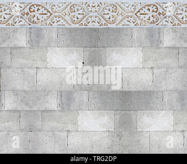 Old white stone wall with molding stone eaves with foliage and plants - image with copy space - Stock Photo