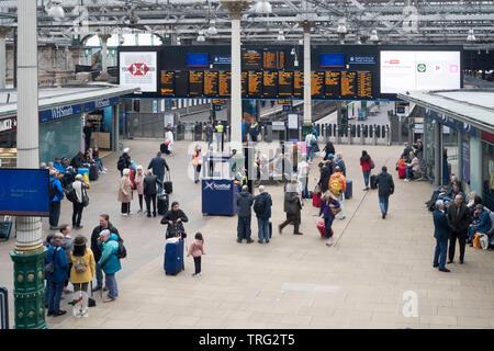 Passengers waiting in the concourse of Edinburgh Waverley  railway station, Edinburgh, Scotland, Europe - Stock Photo