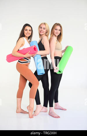 team of sporty yogi girls in class in yoga pose sitting
