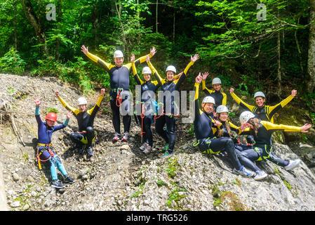 Canyoning group has fun in wild canyon in Allgäu - Stock Photo