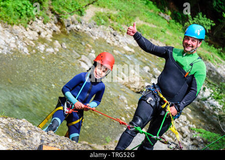 Canyoning - thumbs up for the adventure in canyon - Stock Photo