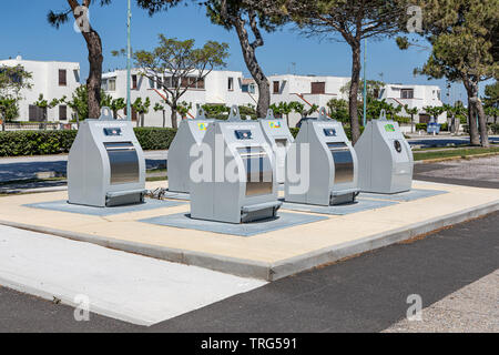 Refuse and recycling bins in Le Barcares, South of France - Stock Photo