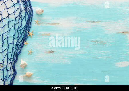 Top view of Fishnet on pastel blue wooden background. top view, flat lay - Stock Photo