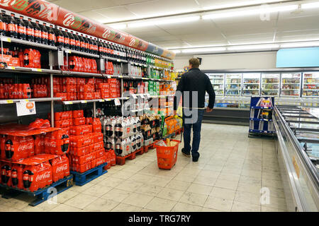 Aisle containing exclusive Coca-Cola Company products in a Delhaize supermarket. - Stock Photo