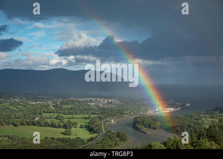 Rainbow over the Newry River (which marks the Eire/UK border) and Warrenpoint from Flagstaff, Co Down, Northern Ireland, UK - Stock Photo