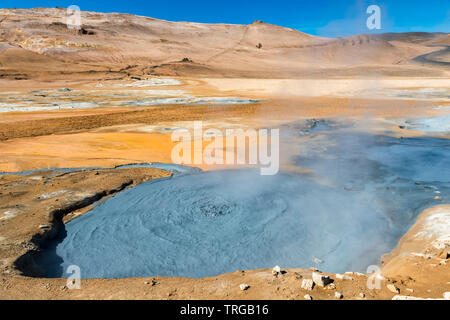 A boiling mudpot in the highly active geothermal area at Námafjall (Hverir), near Lake Mývatn in north-east Iceland - Stock Photo