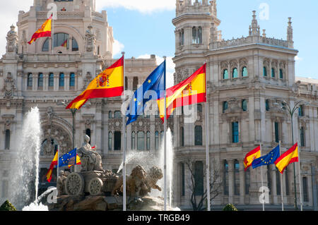 Cibeles fountain with European and Spanish flags commemorating the Spanish Presidency of European Union. Madrid, Spain. - Stock Photo