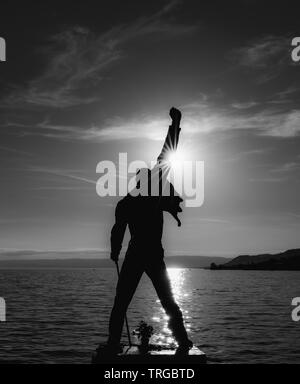 Montreux, VD / Switzerland - 31 May 2019: the Freddie Mercury Memorial Statue on the shores of Lake Geneva in Montreux at sunset - Stock Photo